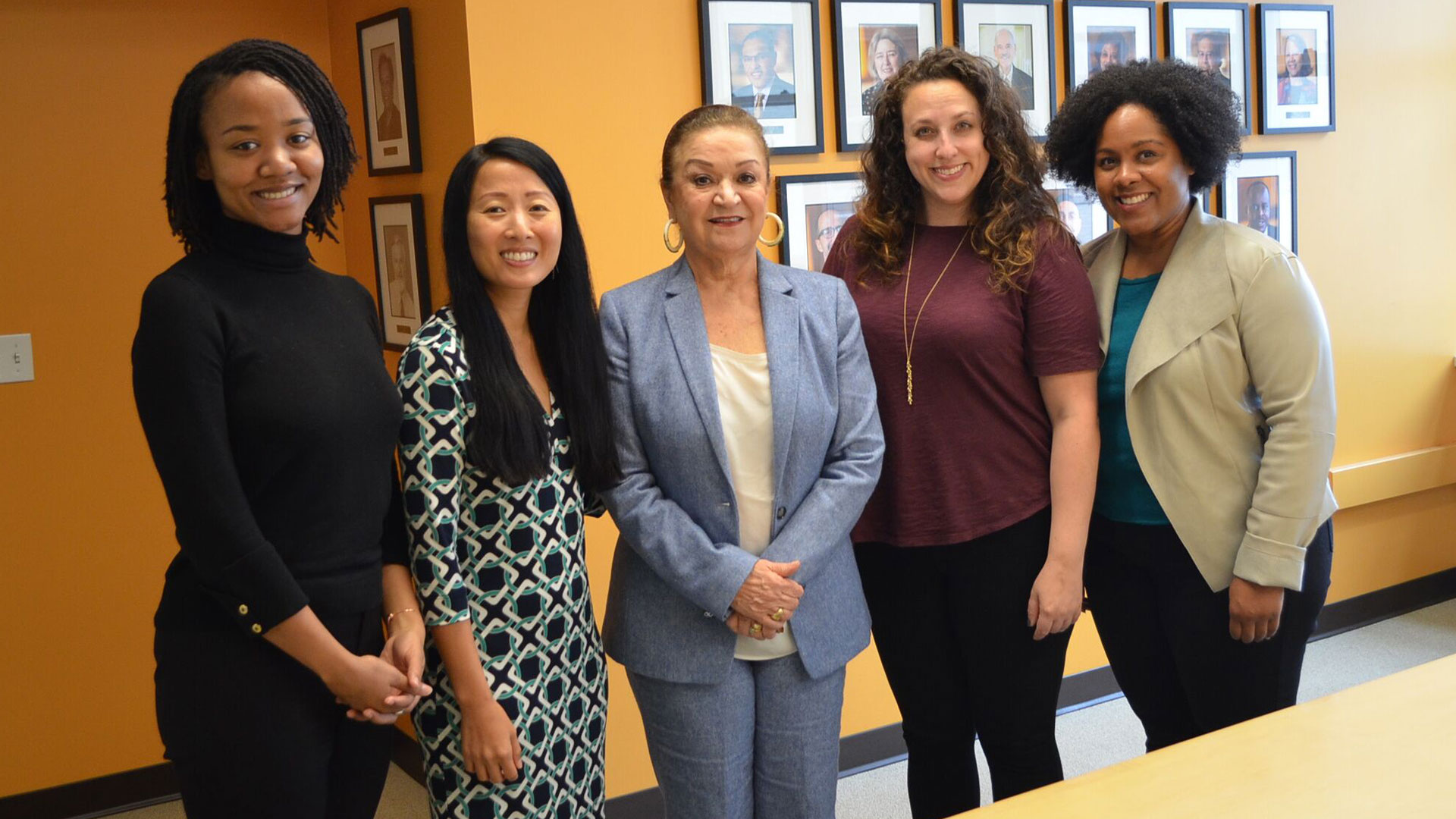 Luz Vega-Marquis standing with her four Momentum Fellows