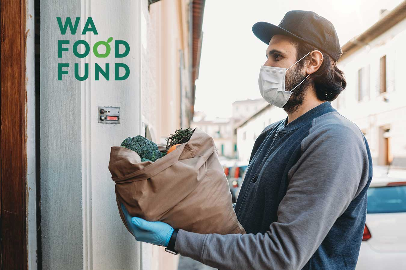 WA Food Fund image with a man in hygiene mask and gloves delivering bag of food standing in a doorway