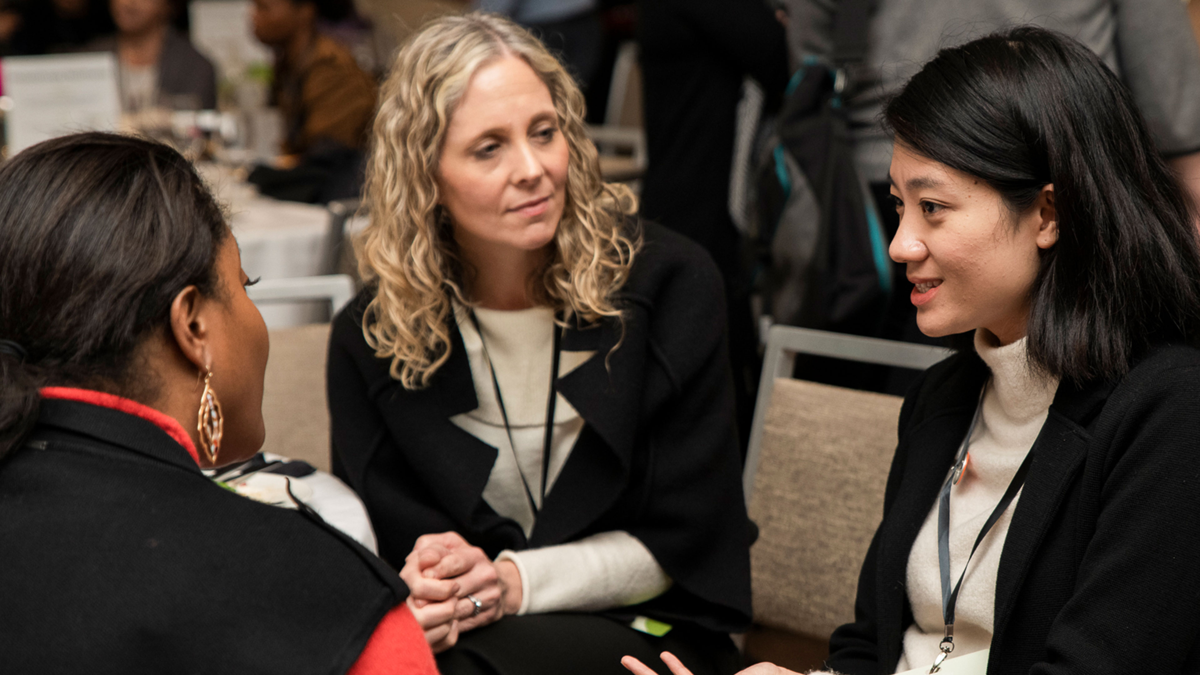 Picture of three women in conversation