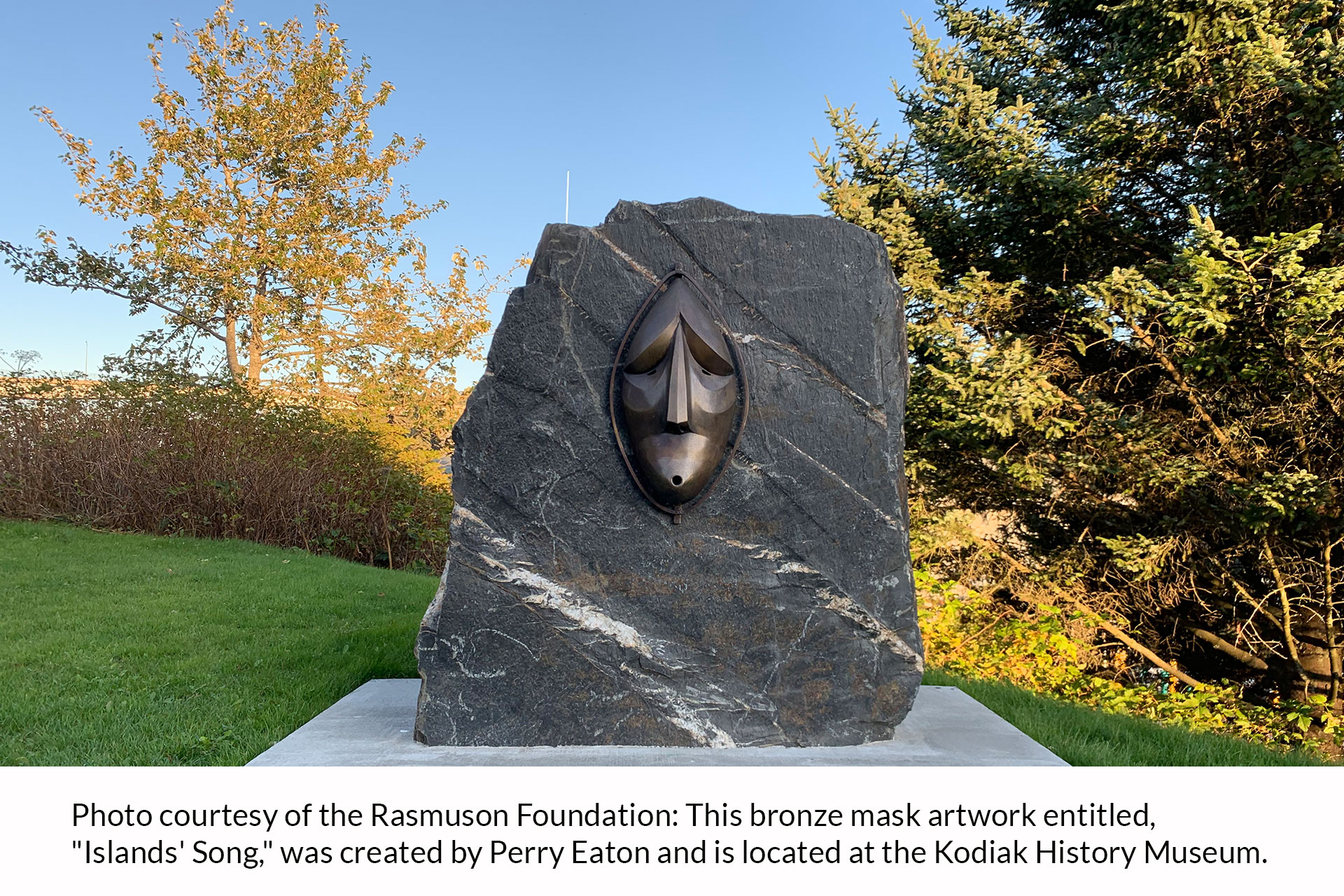 "Photo courtesty of the Rasmuson Foundation: This bronze mask artwork entitled ""Islands' Song"" was created by Perry Eaton and is located at the Kodiak History Museum."