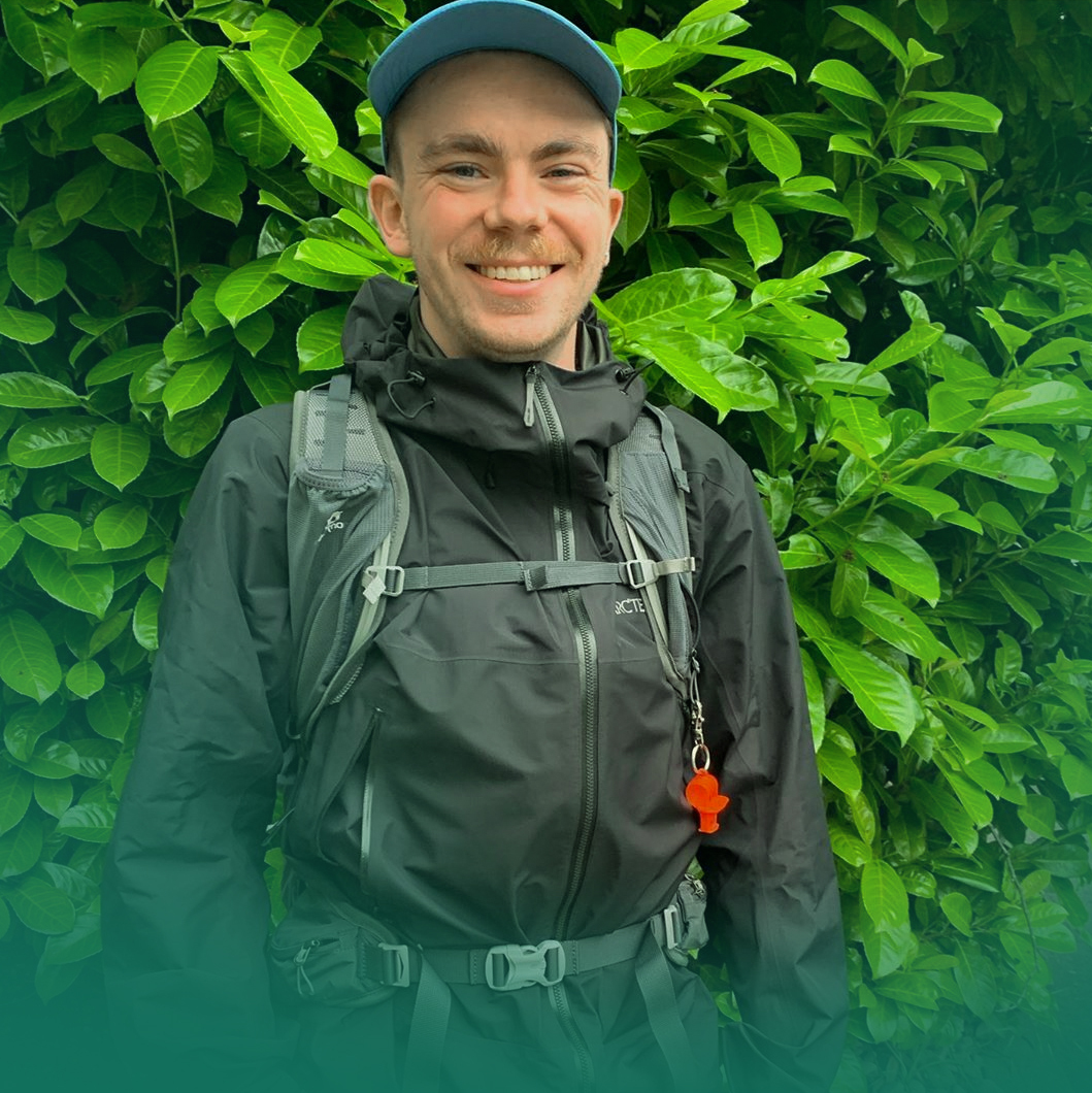 WA Food Fund image with Thurston Weaver wearing his walking gear in front of a green shrub.