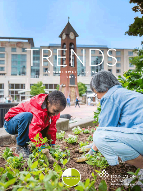 Image of Trends in NW Giving 2017 report cover with a boy and a woman working in a garden