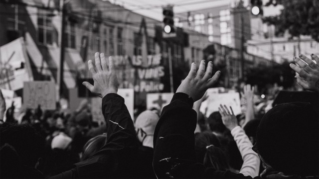 Black and white photo of people attending the protests in the summer of 2020