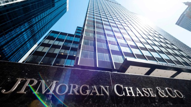 A view of JBMorgan Chase & Co office towers with the company name prominently shown with an angle of sunlight accent