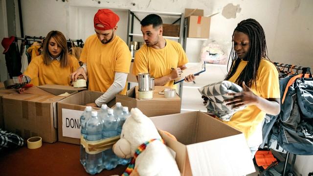 Volunteers sorting donated items