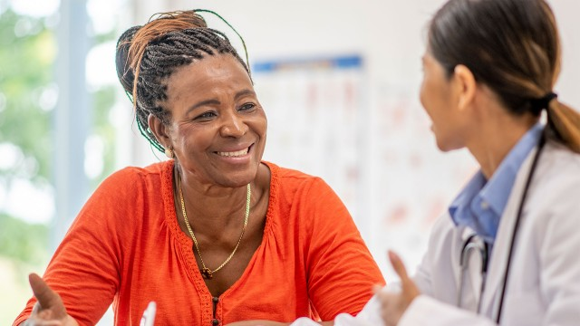 Older woman in medical consultation with her doctor