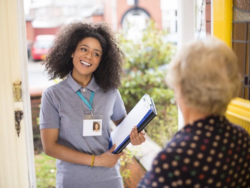 Census worker at an older women's doorstep