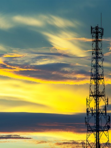 Telecommunication tower with a sunset sky background