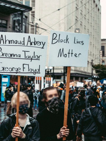 Protesters in Seattle with Black Lives Matter signs