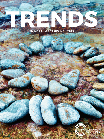 Image of Trends in NW Giving report cover with a spiral of rocks in water